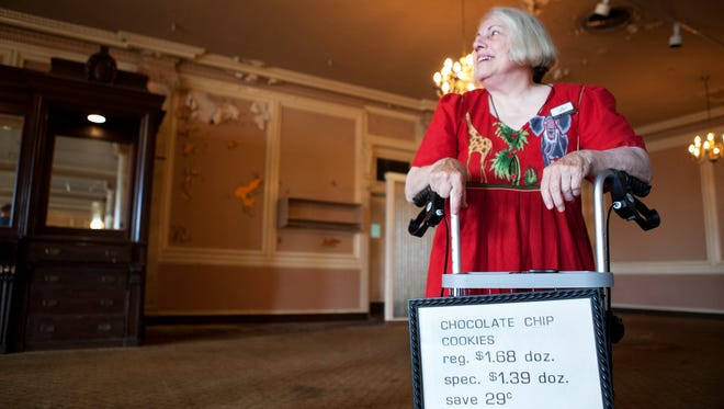 Jean Lindsay looks around the dining room in the downtown Sibley building as a sign she stole from the old Sibley Bakery is displayed on her walker. Lindsay is the great-granddaughter of Alexander M. Lindsay, one of the founders of Sibley.