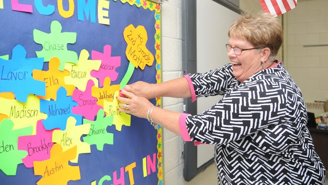 A retired teacher of 30 years, Judy Price sets up a classroom at Princess Anne Elementary, where she will be a long-term sub, a position she has been in for the past 10 years.