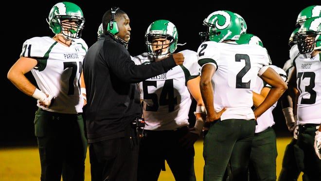 Parkside offensive coordinater Allen Mitchell speaks to his team during a time out against the North Caroline Bulldogs on Friday night in Ridgely.