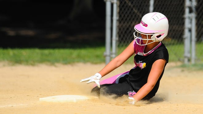 Sussex Slammers second baseman Jordan DiFava slides safely into third during a steal attempt against the Pennsylvania Extreme at Henry S Parker Athletic Complex on Wednesday afternoon as part of the 14U USSSA Softball tournament.