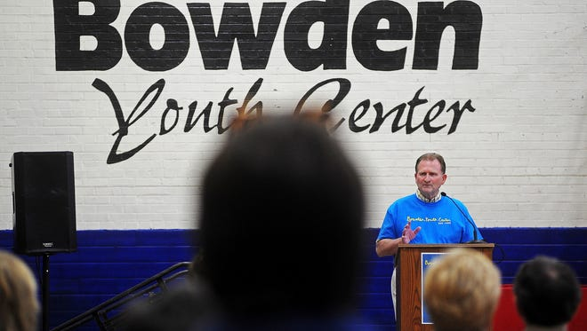 Dennis Hoffman, President and CEO of Volunteers of America, Dakotas, speaks during the Bowden Open House to celebrate the 15th Anniversary of the Volunteers of America, Dakota's Bowden Youth Center on Thursday, Sept. 18, 2014, at the Bowden Youth Center in Sioux Falls, S.D.