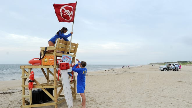 The beach at Cape Henlopen State Park was open Tuesday morning, but the no-swimming flag was posted, a day after a teenager was bitten by a shark.