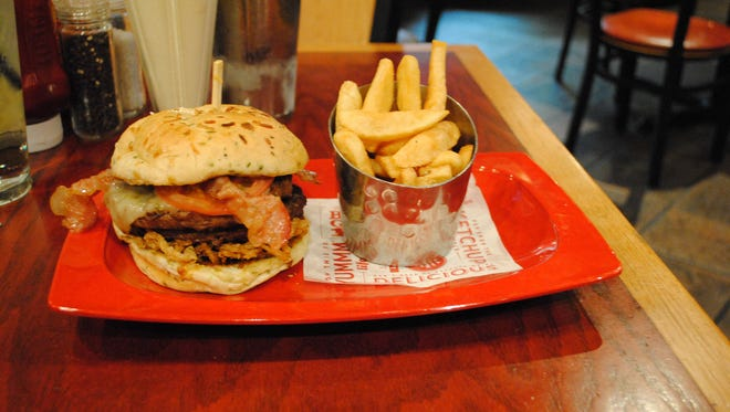 """Red Robin's """"Monster"""" burger, with bottomless steak fries, and a Monster salted caramel milkshake have 3,540 calories, 69 g saturated fat and 6,280 mg sodium. A 12-hour brisk walk would burn off the calories."""