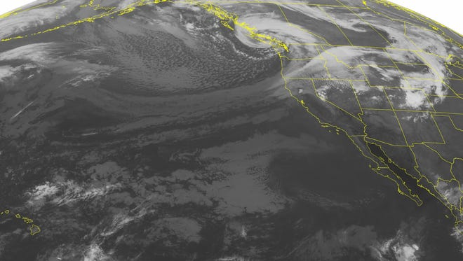This NOAA satellite image taken Monday, Sept. 30, 2013, at 02:00 AM EDT shows an expansive area of cloudiness over the Pacific Northwest associated with a large area of low pressure over coastal British Columbia. Heavy rain and scattered thunderstorms will continue across the region as the system pushes inland. High pressure over the southwestern United States brings mostly sunny skies.