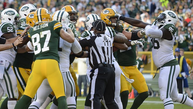Green Bay Packers tackle David Bakhtiari (69) gets into a scuffle with New York Jets defensive lineman Muhammad Wilkerson (96) in the third quarter during Sunday's game at Lambeau Field. Wilkerson was ejected from the game. Evan Siegle/Press-Gazette Media/@PGevansiegle