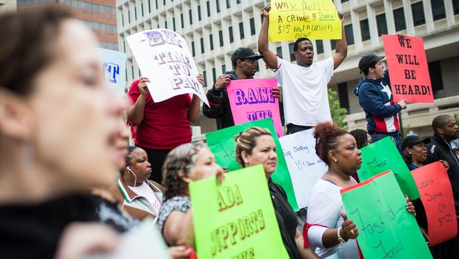 Fast-food workers gathered on North French Street Thursday to call for a wage increase.
