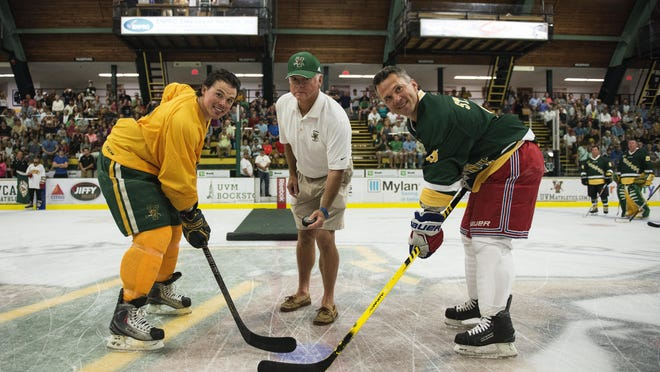 UVM's Dean Strong (left), Martin St. Louis, and coach Mike Gilligan (center) pose for a ceremonial face off before the start of the Greatest Pickup hockey game ever featuring UVM 1996 men's hockey team and alumni at Gutterson Fieldhouse on Saturday morning in Burlington.