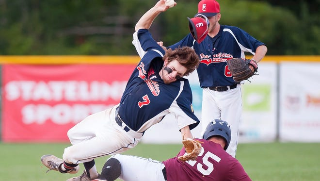 White River Junction's Hunter Perkins (25) slides into the legs of Franklin County shortstop Caleb LaRoche during the second game of the American Legion baseball championship on Friday in Hartford.