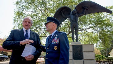 Rod Frazer, left, chats with Lt. Gen. Steven Kwast in front of the new Daedalus statue being installed at Maxwell Air Force Base in Montgomery, Ala., on Thursday March 23, 2017. The statue will be dedicated on April 6.