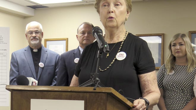 """FILE - In this June, 26, 2019 file photo, Barbara Listing, president of Right to Life of Michigan, joins other anti-abortion advocates to officially launch a ballot drive to restrict a common second-trimester abortion procedure opponents call """"dismemberment,"""" and known medically as dilation and evacuation, during a news conference, in Lansing, Mich. Michigan's elections bureau says the group failed to collect enough petitions to put veto-proof legislation before the Republican-led Legislature that would prohibit a second-trimester abortion procedure. The June 15, 2020 report was a blow to the Michigan Values Life committee."""