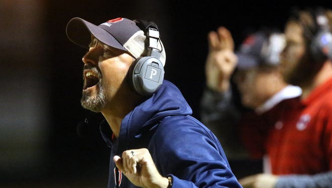 Oakland's head football coach Kevin Creasy, yells instructions from the sidelines during the Smyrna vs. Oakland football game, at Smyrna, on Friday Oct. 30, 2015.