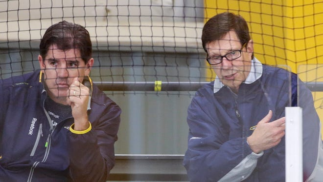 Coach Peter Laviolette, left, has the Predators atop the NHL standings, but general manager David Poile is ready to make some trades to bolster the roster for the postseason.