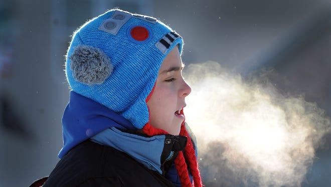Frigid temperatures had Hoosiers bundling up Wednesday morning and they weren't happy about it.