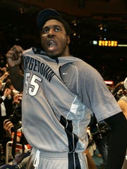 Georgetown's Roy Hibbert gestures toward the crowd after Georgetown won the championship round of the Big East conference tournament  Sunday, March 11, 2007, at Madison Square Garden  in New York. Georgetown won the game, 65-42. (AP Photo/Frank Franklin II)