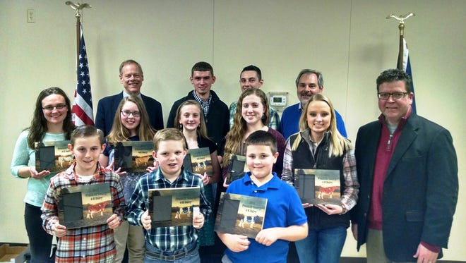 Franklin County 4-H Dairy Award Winners: Back (L-R) Franklin County Commissioner Bob Ziobrowski, Jeremy Laman, Chambersburg, Skyler Reichard, Chambersburg, 4-H Extension Educator Michael Martin. Middle (L-R) Megan Wingert, Chambersburg, Rebekah Aldrich, Chambersburg, Ellisa Gamby, Chambersburg, Grace Crider, St. Thomas, Erica Cauffman, Chambersburg, Franklin County Commissioner Dave Keller. Front (L-R) Andrew Burkholder, Chambersburg, Garrett Fisher, St. Thomas, and Wyatt Cordell, St. Thomas.