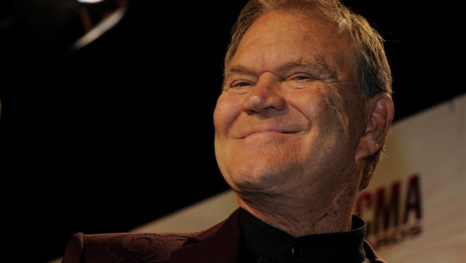 Glen Campbell, seen here at the 2011 CMA Awards in Nashville, was buried Wednesday.