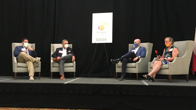 Cal Wray (from left), president of the Augusta Economic Development Authority; Robbie Bennett, executive director of the Development Authority of Columbia County; Will Williams, president of the Western South Carolina Economic Development Partnership; and Jennifer Napper, vice president of Perspecta; discuss the cybersecurity industry's local impact during a recent Georgia Economic Developers Association conference in Augusta.