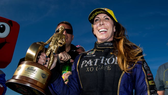 Alexis DeJoria celebrates after winning the Summitracing.com Nationals in Las Vegas on March 30, her second career victory and second of 2014.