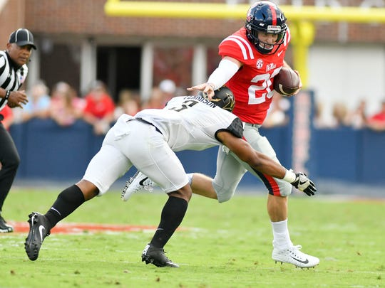 Shea Patterson runs the ball against Vanderbilt cornerback