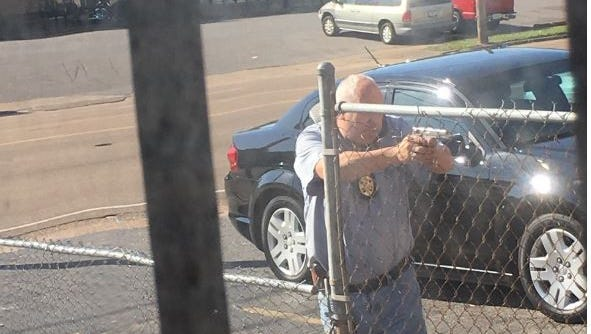 A witness' photo shows an off-duty Memphis Police Department officer detaining a suspect who police said tried to pawn two explosive devices at Accent Guns and Loans on Summer Avenue.