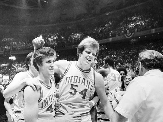 Kent Benson (54), right, of Indiana, is congratulated