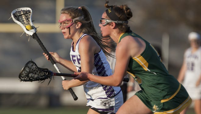 Rumson's Maggie Jennings tries to work her way by Red Bank Catholic's Olivia Farrington during second half action.  Red Bank Catholic vs Rumson-Fair Haven Girls lacrosse in Rumson, NJ on April 29, 2015. Peter Ackerman/Staff Photographer