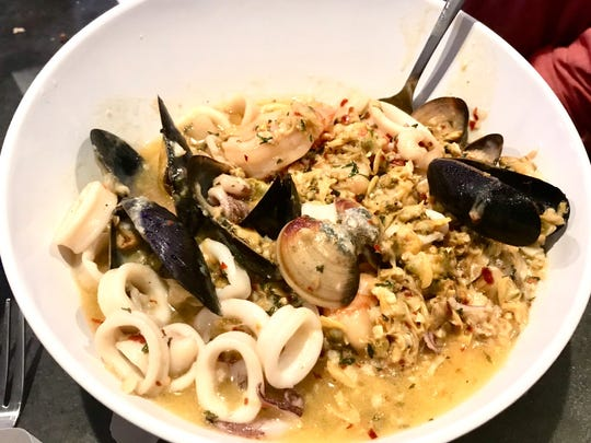 The zuppa de pesce ($20.99) seafood entree features clams, shrimp, calamari and mussels simmered in its own juices, served with a homemade olive oil, garlic and white wine sauce. Diners have a choice of mild, medium or hot.