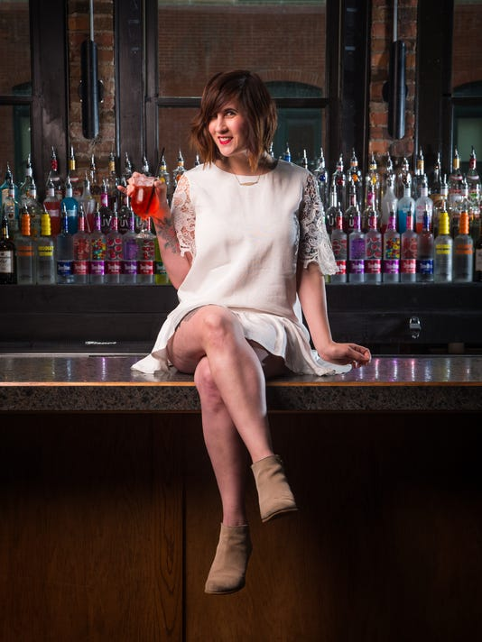 Megan Staker, 31, on the bar at Jokers.