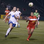 Sydney Leroux, right, chases after a ball in the Flash's home opener on May 2. It was one of the three matches she played in for WNY.