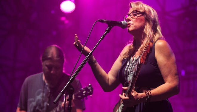 Susan Tedeschi, right, and Derek Trucks lead the Tedeschi Trucks Band Wednesday at the Farm Bureau Insurance Lawn at White River State Park.