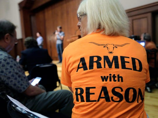 Professor Ann Cvetkovich waits to speak during a public forum as a special committee studies how to implement a new law allowing students with concealed weapons permits to carry firearms into class and other campus buildings, Wednesday, Sept. 30, 2015, in Austin, Texas.