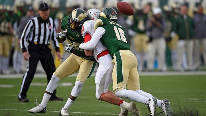 CSU safeties Kevin Pierre-Louis, left, and Trent Matthews team up to break up a pass to New Mexico tight end Reece White during a 2014 game at Hughes Stadium. Matthews and Pierre-Louis have both signed contracts with Canadian Football League teams for the 2017 season, CSU announced Monday.