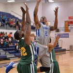 Faulkner's Monta Sanford powers up for two points in loss to Concordia.