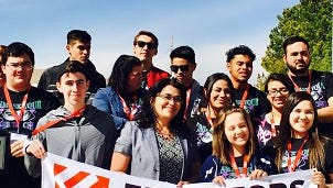 The Deming High School Chapter of Educator's Rising poses with state director Dr. Karen Trujillo during the state conference held Feb. 26-28, at NMSU.