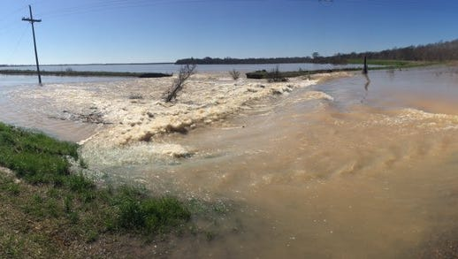 Water spilling into fields from a Lafourche diversion canal off Louisiana 15 just inside Richland.