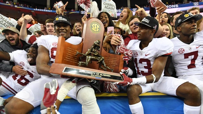 Alabama celebrates its SEC championship after beating Florida 54-16.