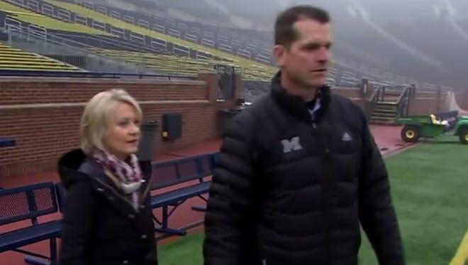 HBO's Andrea Kremer speaks with UM football coach Jim Harbaugh at Michigan Stadium.