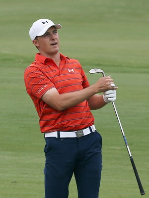 Jordan Spieth watches his shot on the 11th hole Saturday.