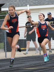 Galion's Jalyn Oswald hands the baton off to Kerrigan Myers in the 4X100 relay at the D-II regional meet at Lexington High School on Saturday.
