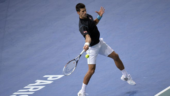 Novak Djokovic lines up a forehand during his victory against France's Pierre-Hugues Herbert.