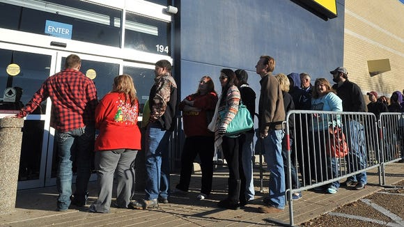 Shoppers lined up outside the Best Buy in Flowood on Black Friday last month. The Friday after Christmas will be another busy day for area retailers.