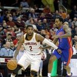 Detroit center Andre Drummond drives against Cleveland guard Kyrie Irving during the first quarter of an April 9 game.
