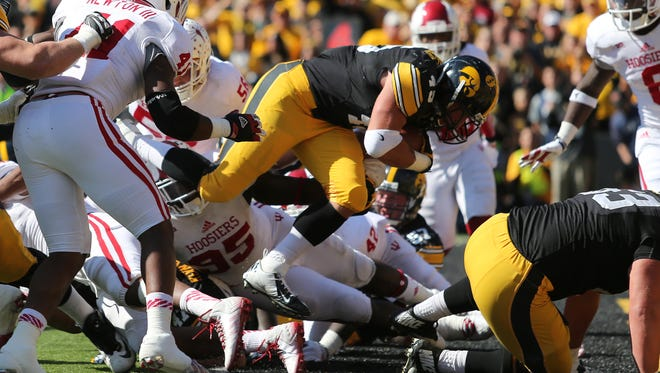 Iowa running back Mark Weisman runs the ball up the middle for a touchdown in the final seconds of the first half against Indiana on Saturday, Oct. 11, 2014, at Kinnick Stadium in Iowa City, Iowa.