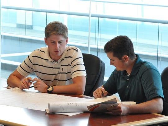 Nick Volker, left, and Jim Goddard, right, HVAC engineers