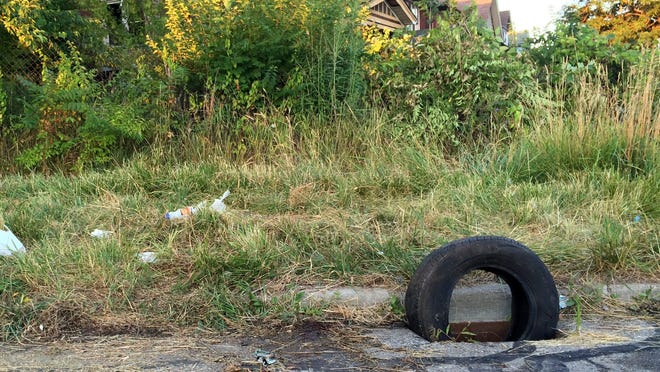 A tire was used to block a sewer grate  July 24 at Oregon Street and the I-96 service drive after a man's body was found in the hole. In the last 18 months, five people have been found in manholes, three of them dead.