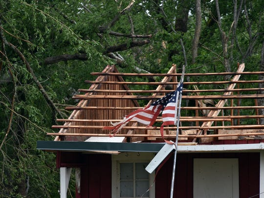 Downed trees surround a home on Blackjack Road in Yazoo County that lost its roof during a storm that hit most of Mississippi.