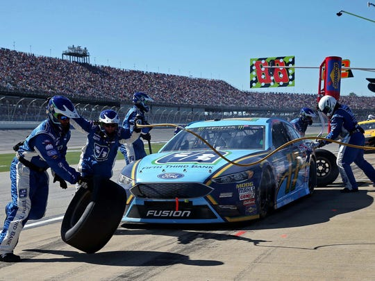 NASCAR Cup Series driver Ricky Stenhouse Jr. (17) makes a pit stop during the GEICO 500 at Talladega Superspeedway.