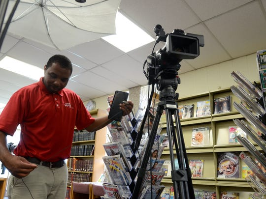 C-SPAN Book TV producer, Johnny St. Jean, packs up his camera gear Monday, June 20, at the St. Clair County Library main branch in Port Huron.