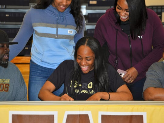 Battle Creek Central senior Ayrianna Smith is all smiles as she signed her National Letter of Intent on Wednesday to run track at Western Michigan University.