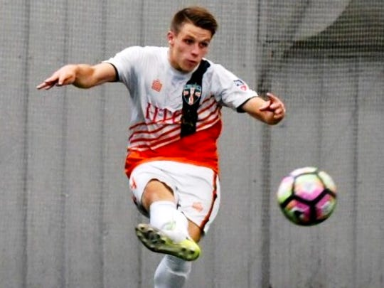 Bucks midfielder Jay Dunwell moves the ball in Friday's Central Conference playoff game against Des Moines.